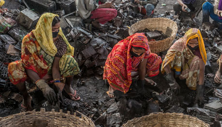 Patna, India. Women at work in recycling operation